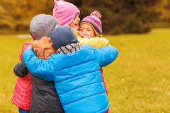 Group of happy children hugging in autumn park Royalty Free Stock Image