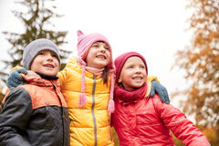 Group of happy children hugging in autumn park Stock Photography