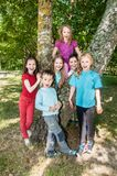 Group of happy children outdoors stock image