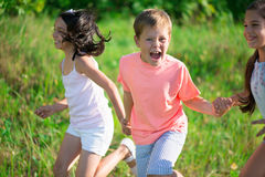 Group of happy children playing Stock Photo