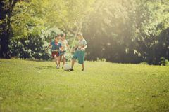 Group of happy children playing with soccer ball royalty free stock photo