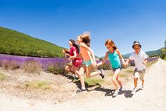 Group of happy children running in lavender field Stock Photo