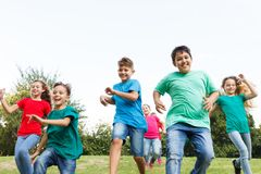 Group of happy children. Running outdoors Stock Images