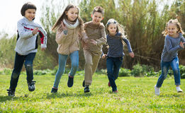 Group of happy children running in race outdoors Royalty Free Stock Photo