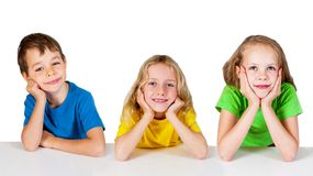 Group of happy children at the table royalty free stock photos