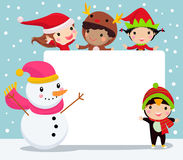 Group of happy children and snowman. Royalty Free Stock Image