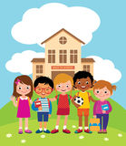 Group of happy children standing in front of the school building Royalty Free Stock Photo