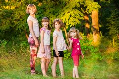 Group of happy children walk together in summer royalty free stock images