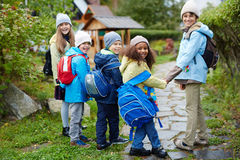 Group of Happy Children Walking to School in Autumn royalty free stock photos