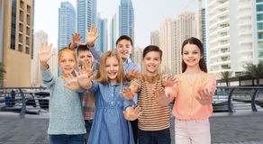 Group of happy children waving hands Royalty Free Stock Photo