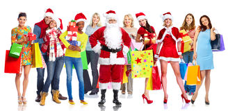 Group of happy Christmas people with gifts. royalty free stock photography