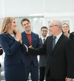 Group of happy colleagues communicating in office Royalty Free Stock Photo