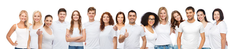 Group of happy different people in white t-shirts royalty free stock photos