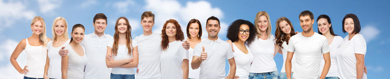 Group of happy different people in white t-shirts stock photo