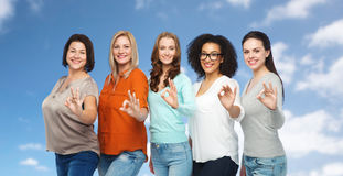 Group of happy different size women showing ok Royalty Free Stock Photography