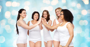 Group of happy different women making high five Royalty Free Stock Photo