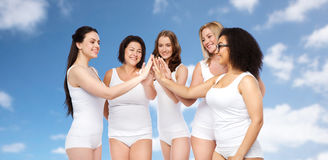 Group of happy different women making high five Stock Photo