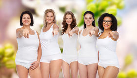 Group of happy different women pointing on you Stock Image