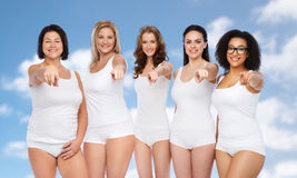 Group of happy different women pointing on you Stock Photography