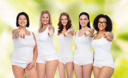 Group of happy different women pointing on you Stock Photo