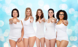 Group of happy different women pointing on you Stock Images