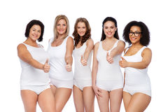 Group of happy different women showing thumbs up Stock Photos