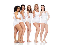 Group of happy different women showing thumbs up Stock Images