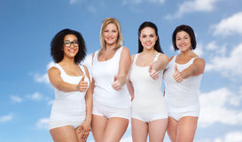 Group of happy different women showing thumbs up Royalty Free Stock Photography