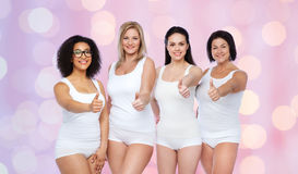Group of happy different women showing thumbs up Stock Photo