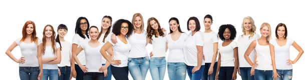 Group of happy different women in white t-shirts. Friendship, diverse, body positive and people concept - group of happy different age and ethnicity women in Stock Photos