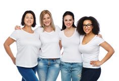 Group of happy different women in white t-shirts. Friendship, diverse, body positive and people concept - group of happy different size women in white t-shirts Royalty Free Stock Photos