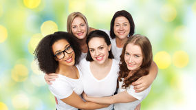 Group of happy different women in white t-shirts Royalty Free Stock Photos
