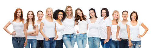 Group of happy different women in white t-shirts. Friendship, diversity, body positive and people concept - group of happy women of different age size and Royalty Free Stock Photo