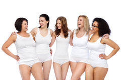 Group of happy different women in white underwear Stock Images