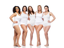 Group of happy different women in white underwear Royalty Free Stock Photography