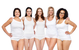Group of happy different women in white underwear Royalty Free Stock Photo