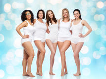 Group of happy different women in white underwear Royalty Free Stock Image