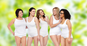 Group of happy different women in white underwear Stock Photography
