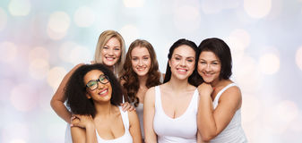 Group of happy different women in white underwear Stock Photo