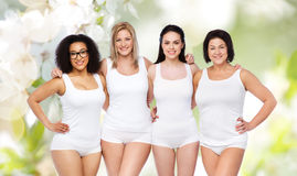 Group of happy different women in white underwear Royalty Free Stock Photos