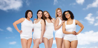 Group of happy different women in white underwear Royalty Free Stock Images