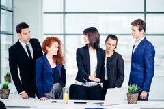 Male and female business people around laptop computer in office Royalty Free Stock Photos