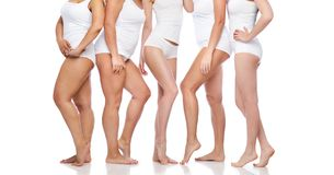 Group of happy diverse women in white underwear. Beauty, body positive and people concept - group of happy diverse women in white underwear Stock Photography