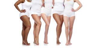Group of happy diverse women in white underwear. Beauty, body positive and people concept - group of happy diverse women in white underwear Royalty Free Stock Photos