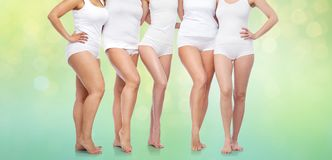 Group of happy diverse women in white underwear Royalty Free Stock Photo