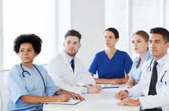Group of happy doctors on conference at hospital Royalty Free Stock Photos