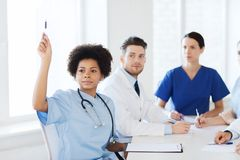 Group of happy doctors on conference at hospital Stock Photo