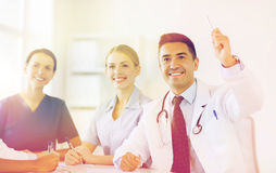 Group of happy doctors on conference at hospital Stock Images