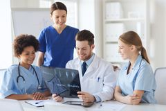 Group of happy doctors discussing x-ray image Royalty Free Stock Image