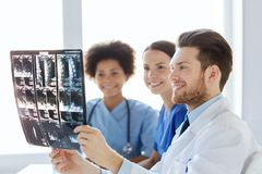 Group of happy doctors discussing x-ray image Stock Photo